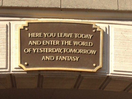 leave today and enter the world of yesterday disneyland sign