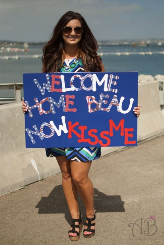 welcome home now kiss me sign
