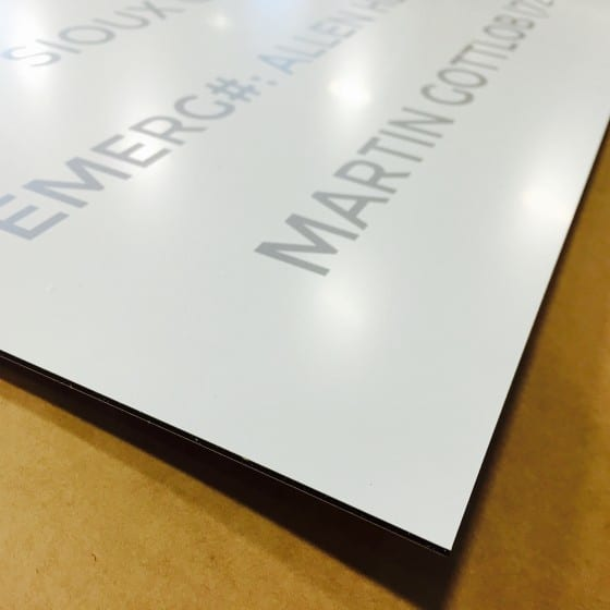 aluminum sign with design not covering entire surface