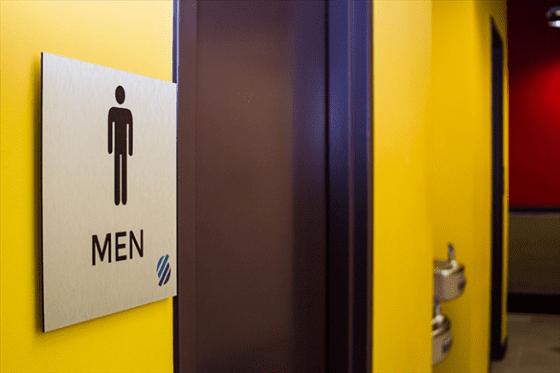 brushed aluminum restroom sign