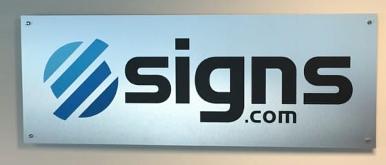 custom brushed aluminum sign with standoffs