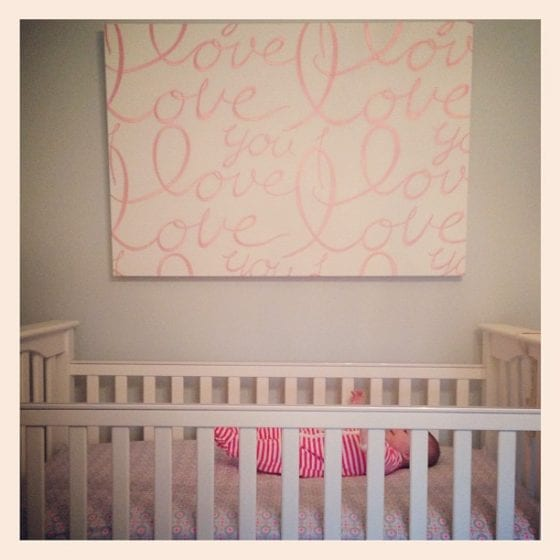 canvas above nursery crib