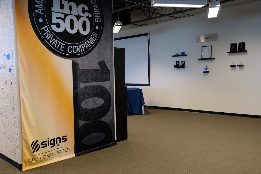 Signs.com Inc. 500 awards wall