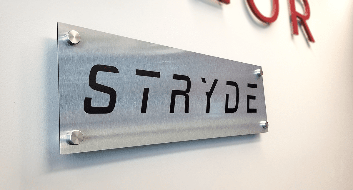 Example of brushed aluminum sign with standoffs.