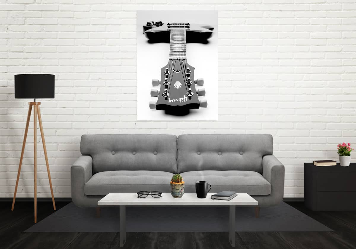 Poster of guitar hanging on a wall in a living room setting
